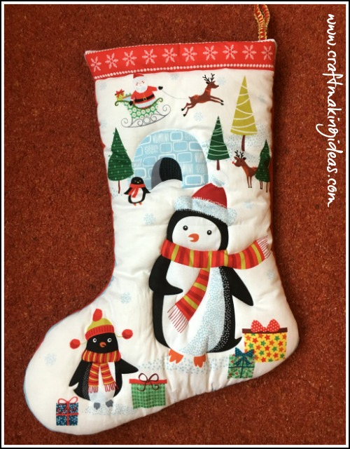 medium penguin themed quilted christmas stocking